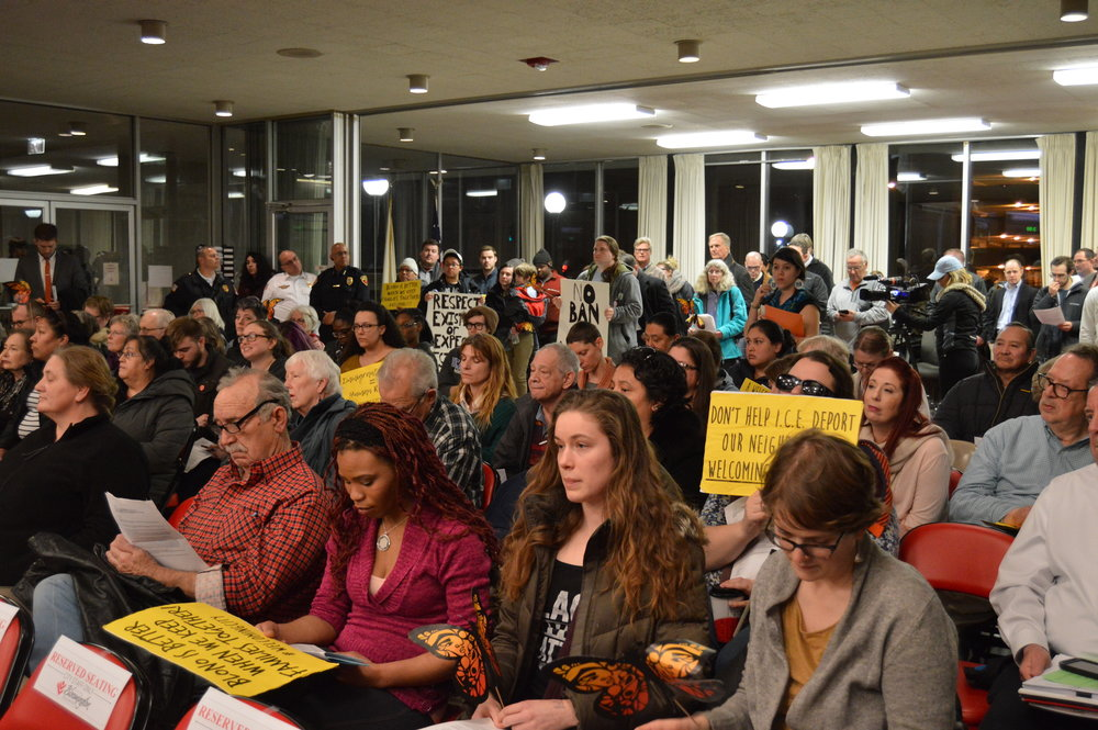 Supporters of the Keep Families Together Coalition packed the council chambers Monday night. (Image Credit: Breanna Grow)