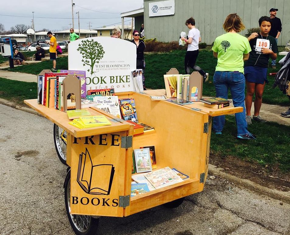 WBRP's Book Bike travels Bloomington's west side to deliver free books to children and adults. (Image Credit: West Bloomington Revitalization Project)