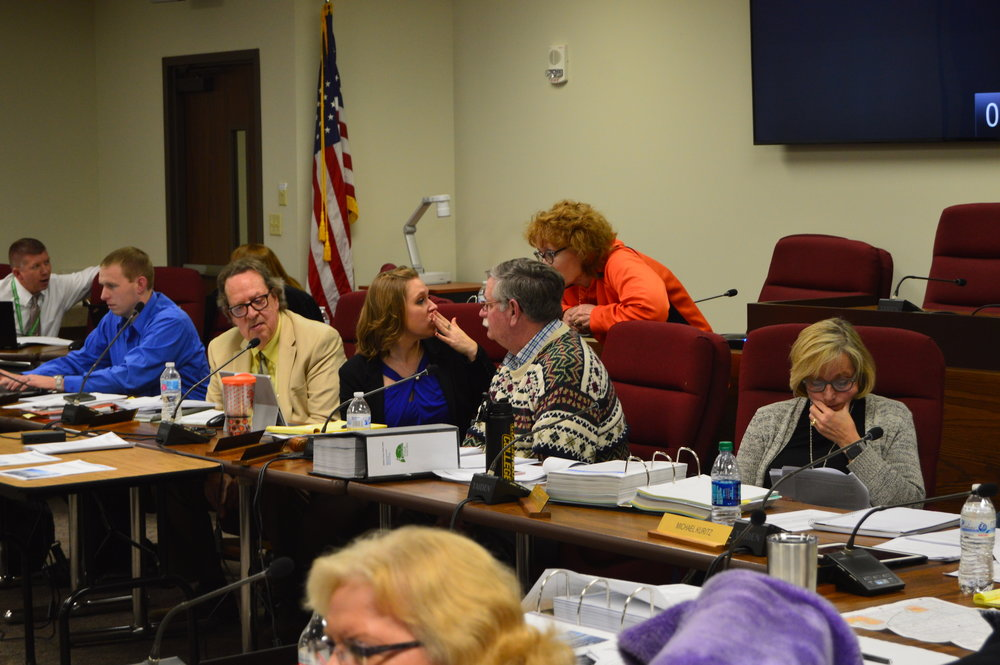 The McLean County Zoning Board of Appeals deliberates on testimony heard Thursday night. (Image credit: Matt Johnson)