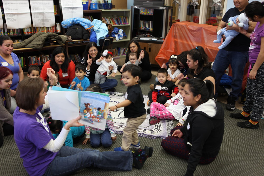 Children participate in story time during a Kindermusik class. Kindermusik was one of three recipients of the 2018 Women to Women Giving Circle grants. (Image Credit: Katie Henderson, Music Connections Foundation).