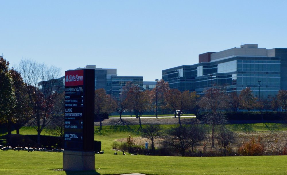 In a statement released Tuesday, State Farm says it plans to cut 890 IT jobs in Bloomington, adding similar positions at company hubs in Atlanta, Dallas and Phoenix.