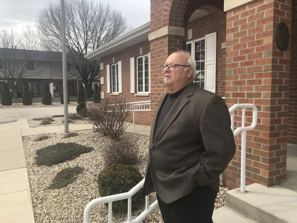 Paul Laiming stands outside the Van Gundy Insurance Agency office on Towanda Avenue in Normal. (Image credit: Erik Prenzler)