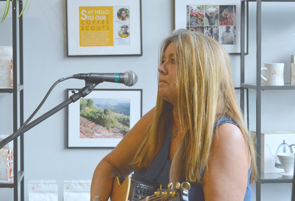 "Jesus House Founder Bonnie Kae Lentz performed Thursday night at The Coffee Hound in Bloomington during an event promoting her new book, ""Stories From The Jesus House."" (Image credit: Breanna Grow)"