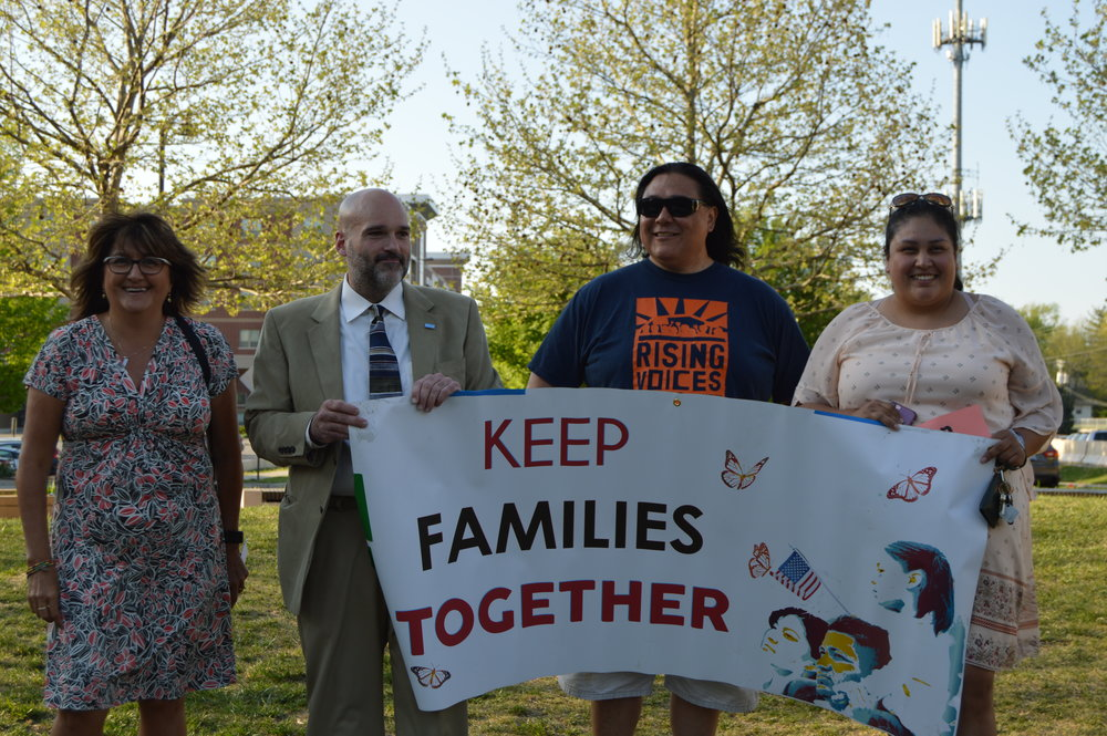 Members of the Keep Families Together Campaign spoke at a rally Monday evening at Uptown Circle. (Photo: Breanna Grow/AdaptBN)