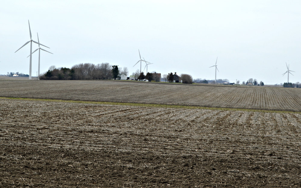 Larry Ryan's 5-acres homestead in Carlock is surrounded in every direction by wind turbines. Ryan says the turbines' effects have been strong enough to change the way he and his family use their property. (Image credit: Breanna Grow)
