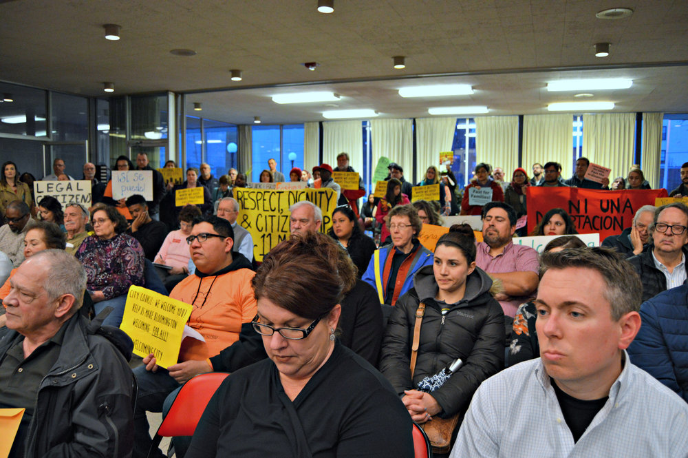 Members of the Keep Families Together coalition staged a walkout at a March 26th Council meeting in protest of council members' inaction on a welcoming city ordinance. (Image credit: Breanna Grow)