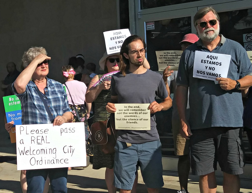 "Members of the Keep Families Together campaign rallied outside Bloomington City Hall Monday evening, when council members were set to consider the proposed ""welcoming city"" ordinance. Bloomington Mayor Tari Renner canceled the meeting Monday morning, citing insufficient council and community support for the proposal. (Photo: Breanna Grow)"