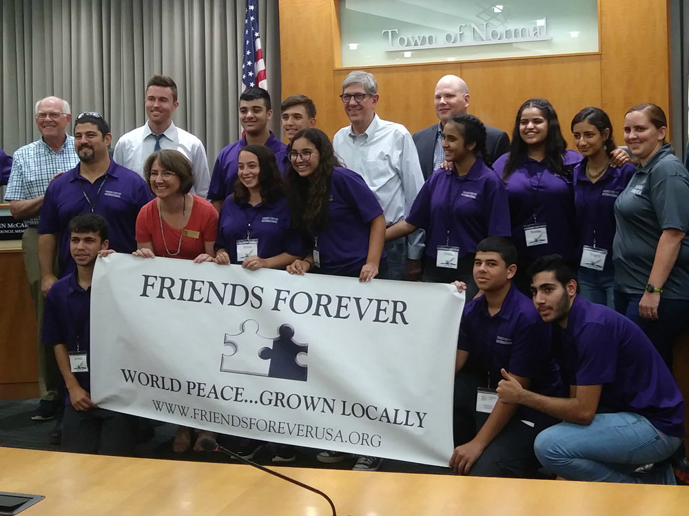 Normal Town Council members met Monday night with participants of Friends Forever, a program to host 10 Arab and Jewish youth from Israel in Normal for leadership and community service activities. (Photo: Breanna Grow)