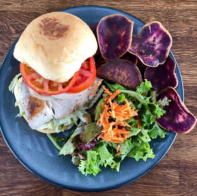 Our Island Fresh Catch Sandwich 🐟 Seared Fresh Fish on our Hoaloha Bakery Potato Bun, with Lettuce, Tomato, Onion & Tartar Sauce w/House Salad and Taro Chips made with Kalo from our own Hoaloha Farms! #delicious #ono #alohamixedplate