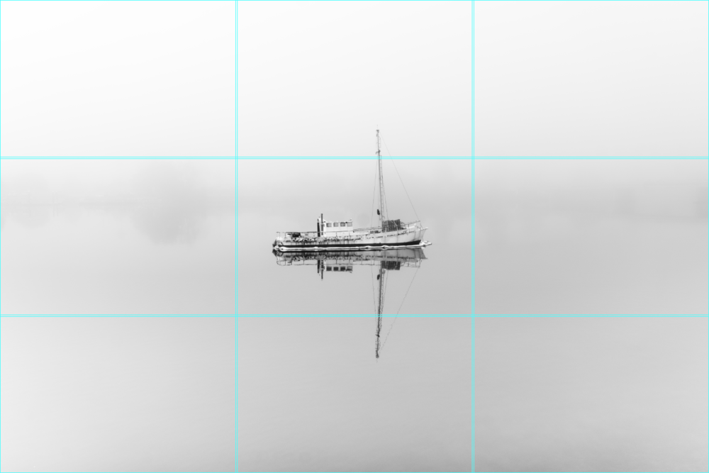 By keeping my subject centred and filling the rest of the frame with minimal detail, my vision of this rusty tugboat lost in the fog is complete.