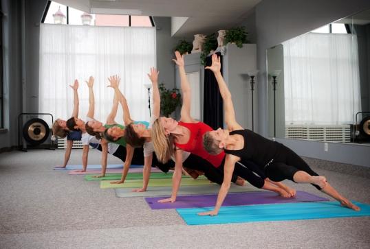 yoga group posed on mats 538px.jpg