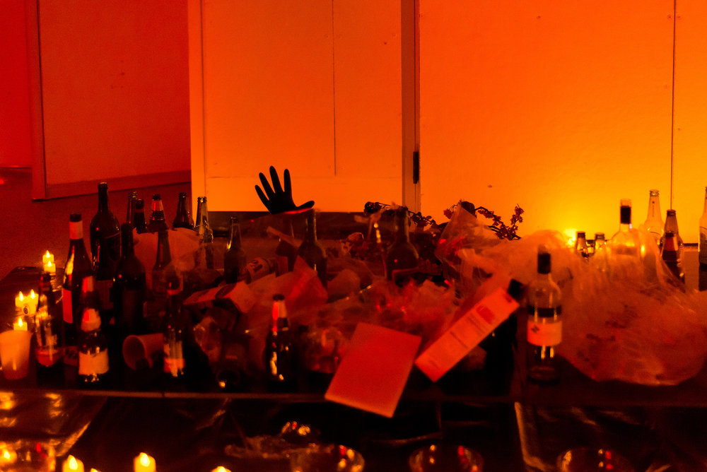 The altar in the late hours of the party, with offerings of plastic debris, empties and spillage