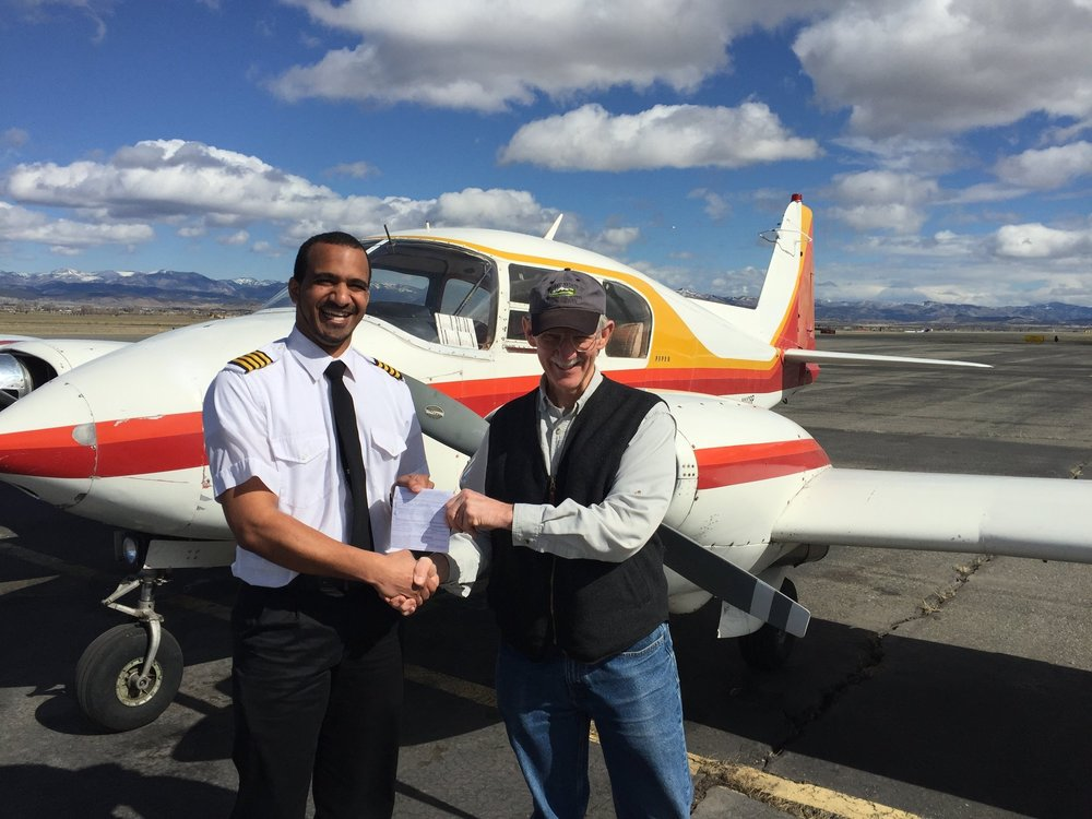 - Certified Flight Instructor Trevor Stene from Missoula, MT is congratulated by Designated Pilot Examiner Bob Van Meter upon successful completion of his MEI checkride.