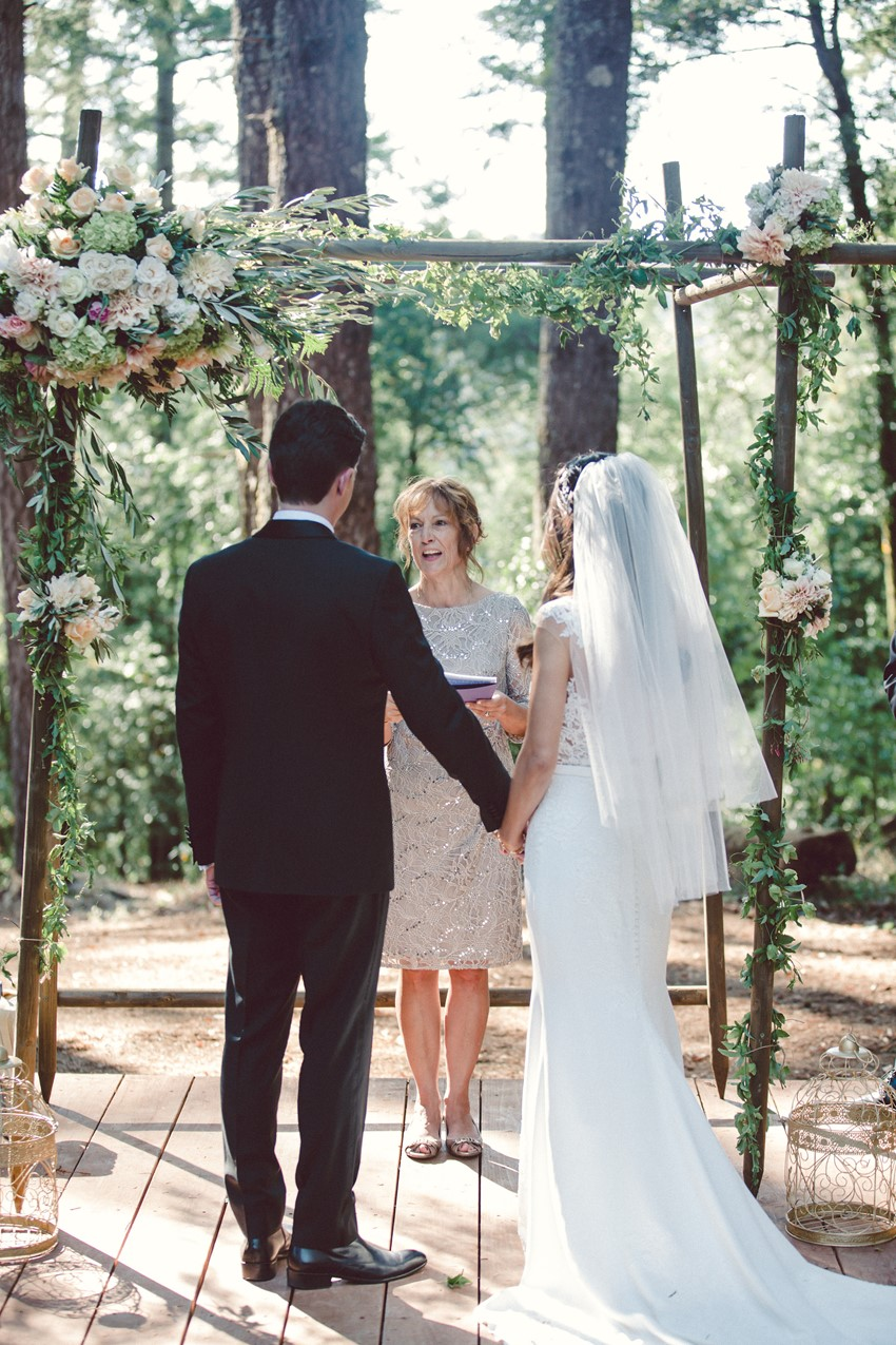 Rustic wedding arch, flowers in blush, ivory and eucalyptus greens. Occidental rustic wedding ceremony in the Grove at Union Hotel.
