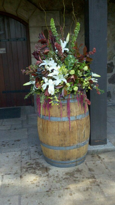 Wine barrel topper with purple and white flowers and greens, V. Sattui wedding ceremony wine barrel