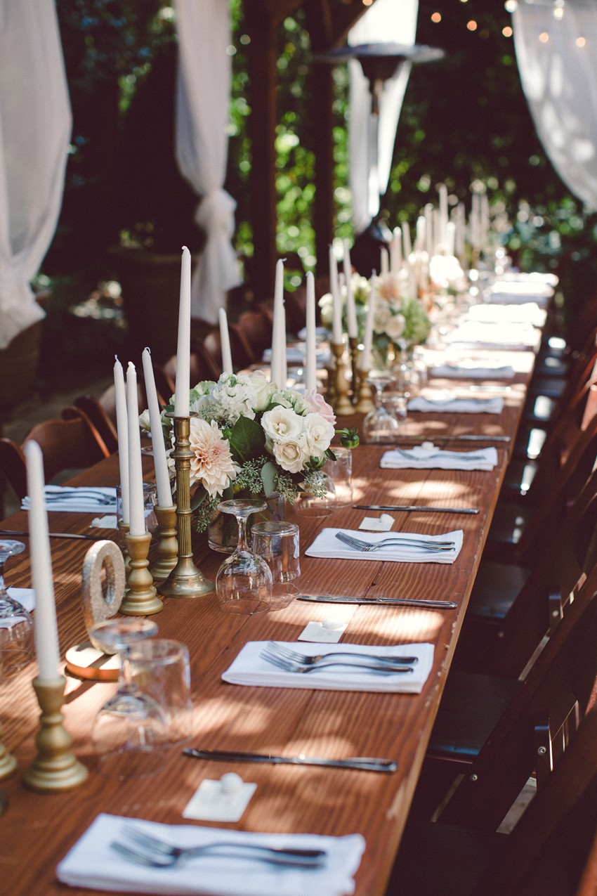 Romantic flowers for rustic outdoor reception table in Sebastopol