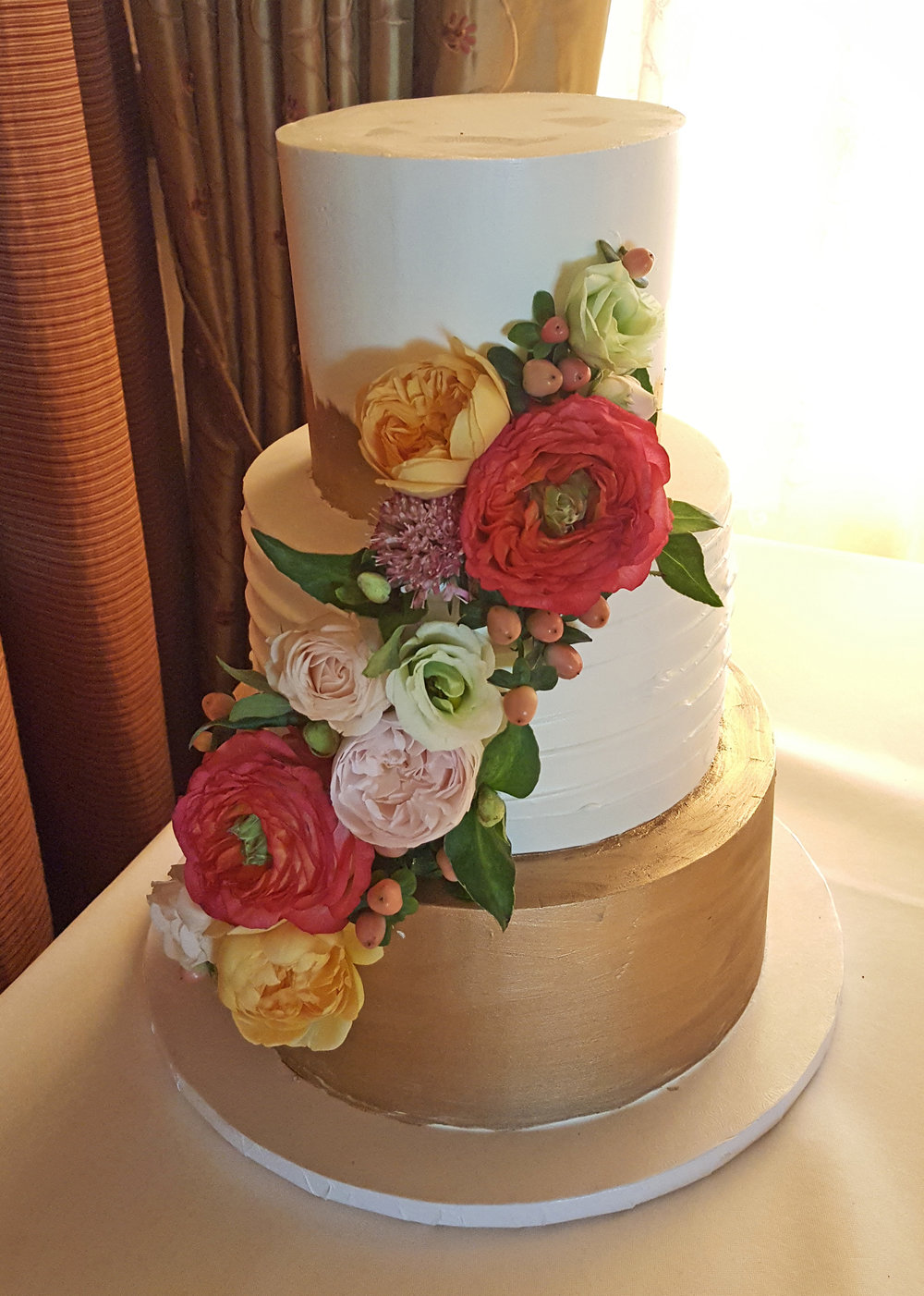 Elegant wine country wedding cake decorated with coral, blush and greens. Wedding cake flowers Sonoma