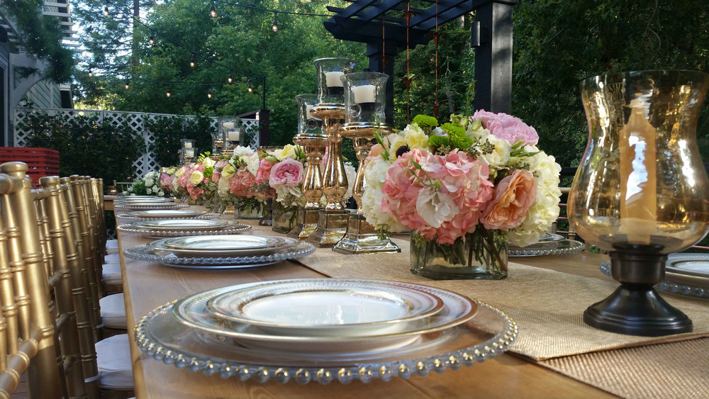 King's table lined with square vases of English roses, peonies, hydrangea and greens. Marin County wedding reception flowers
