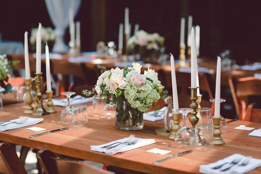 Reception flowers in glass vases include blush, white and green. Roses, hydrangea and ranunculus. Romantic outdoor wedding Sebastopol