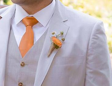 Boutonniere orange ranunculus