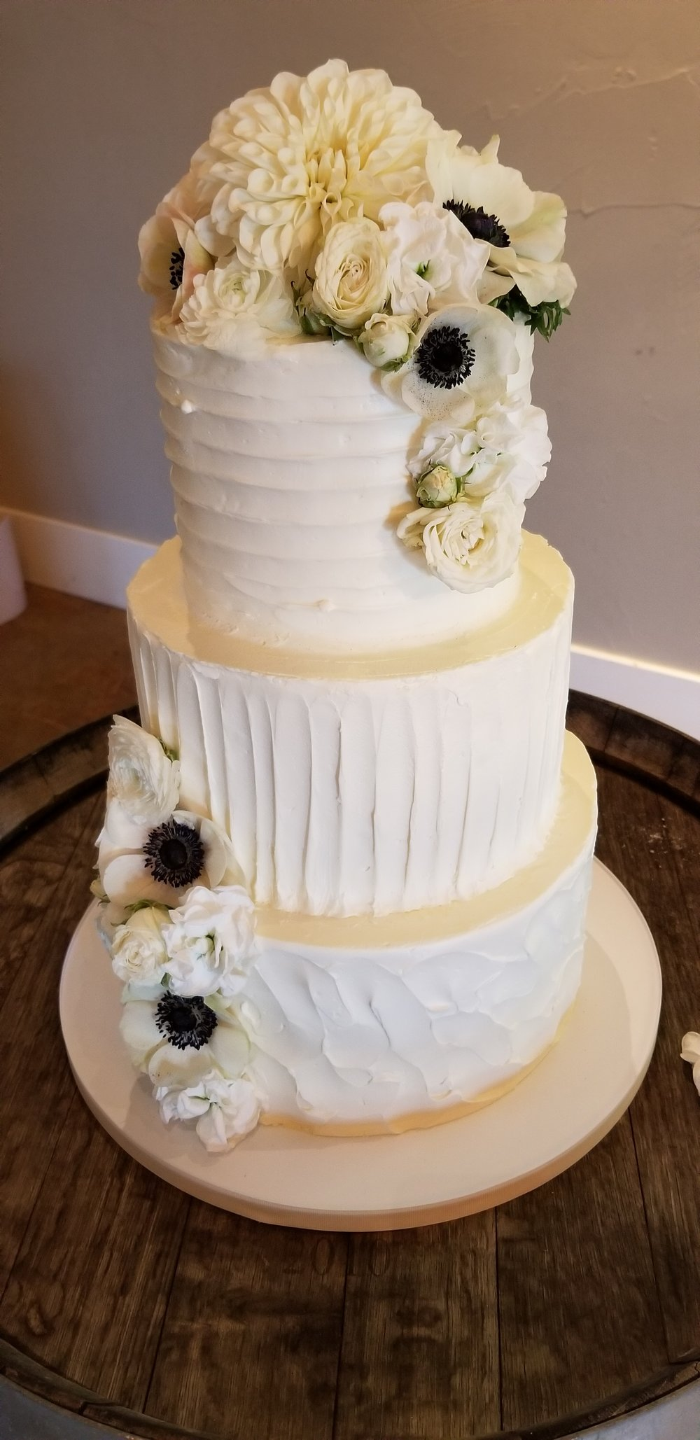 Wedding cake flowers, white dahlia and anemone.