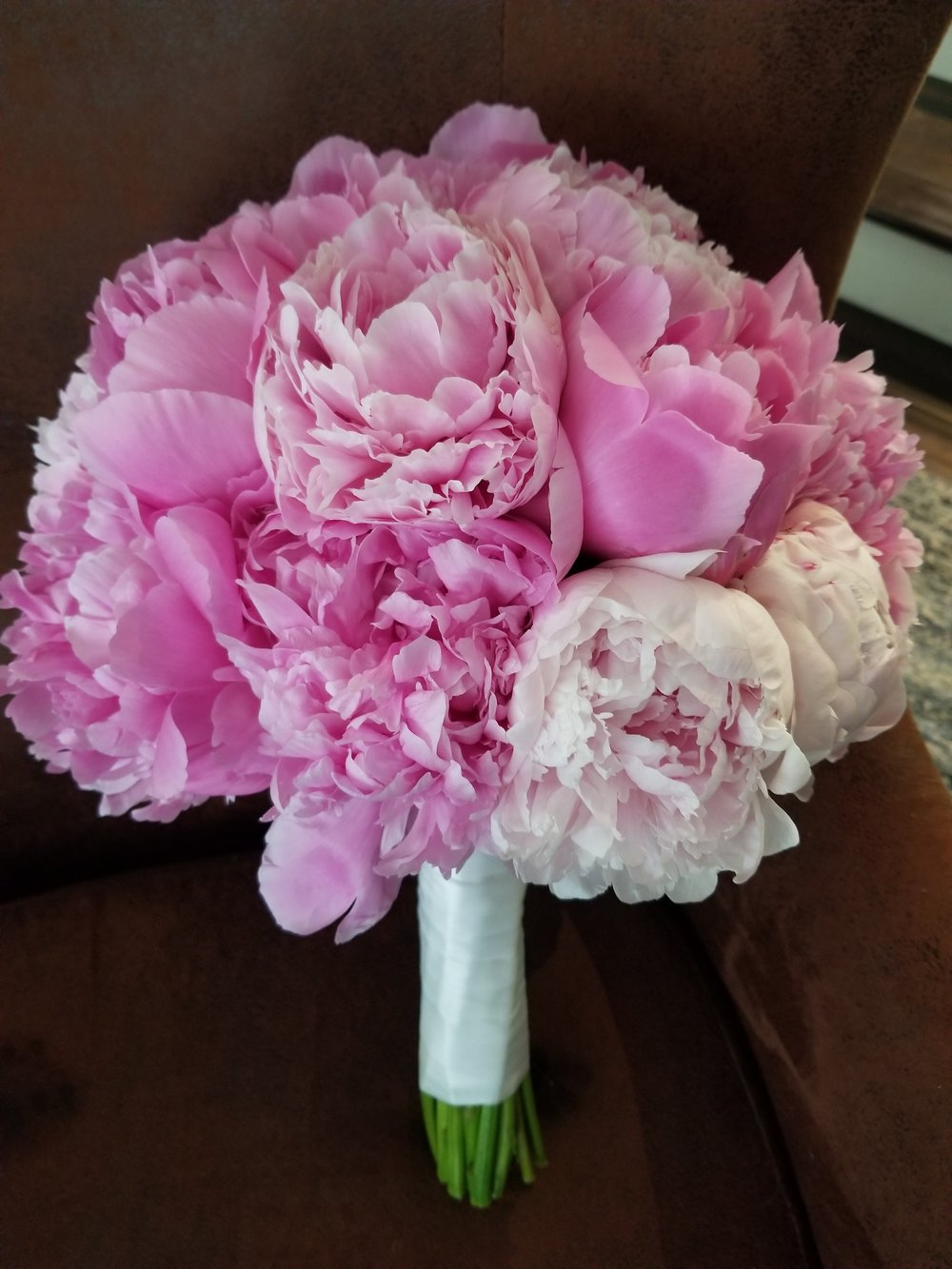 Pretty pink bridal bouquet, all peonies in shades of bright pink and blush.