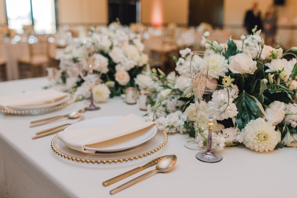 Wedding centerpiece floral in lush whites and blush. Oxford Suites reception.