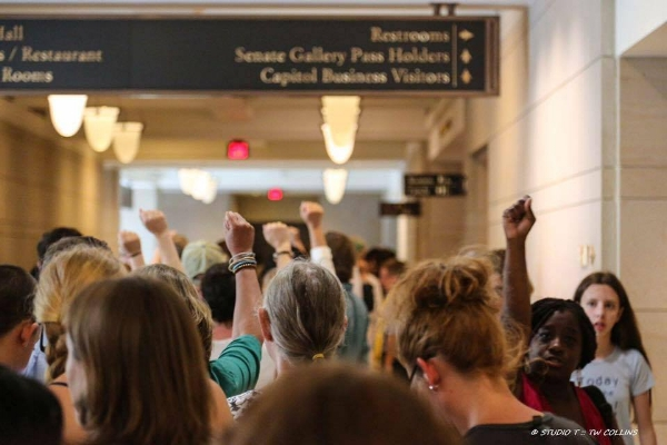 Me, leading a group of 100 protesters in the exercise of their first amendment rights. Everyday people showed great courage and risked much that day, including legal sanctions to stand in solidarity with millions of others. They were inspired, empowered and activated to make change in the world we live in. I want that for your organization.