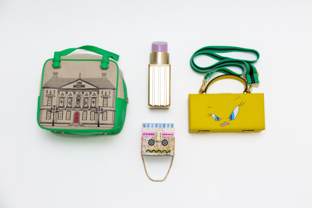 Love Moschino Handbag |    Moschino    (similar), Lipstick Clutch |    Lulu Guiness    (similar), Tweety Bird Guitar Strap Bag | Zara (sold out), Robot Box Clutch | Zara (sold out)