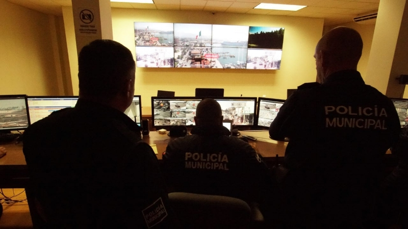 The Ensenada police observing video transmitted from a Cape-equipped drone.