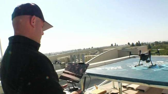 A Chula Vista Police Department officer on the roof of police headquarters where drones launch