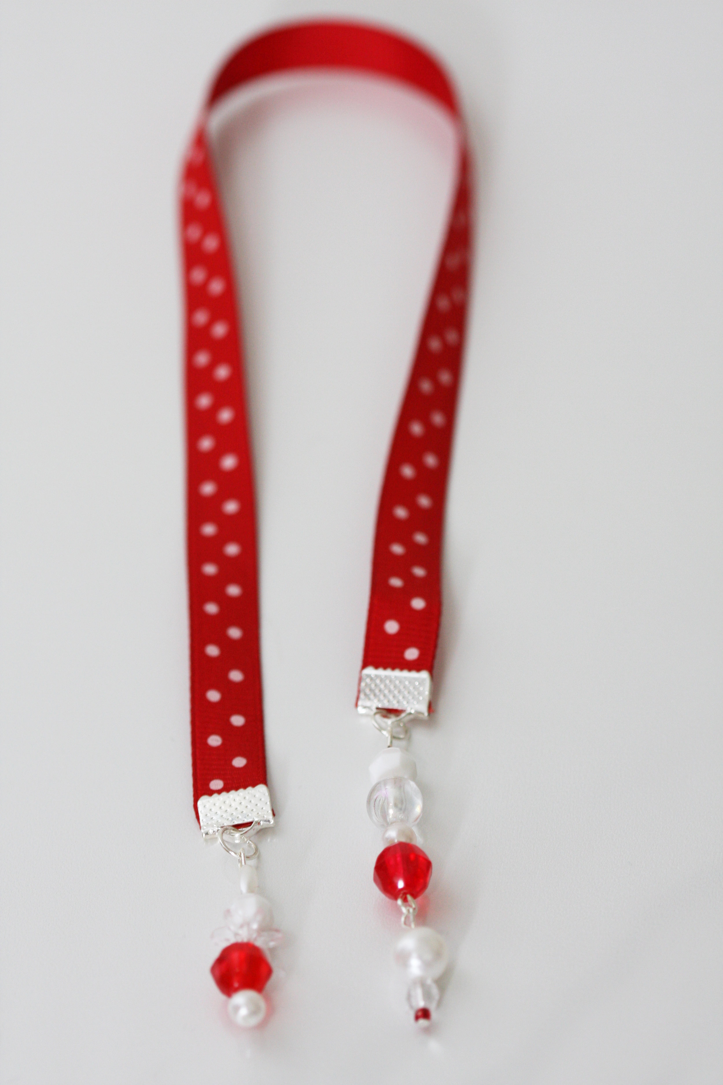 Retro-inspired beaded ribbon bookmark with polka dots a la Lucille Ball.