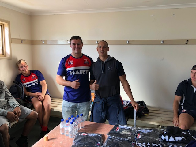 Liam Bilston being presented his jersey