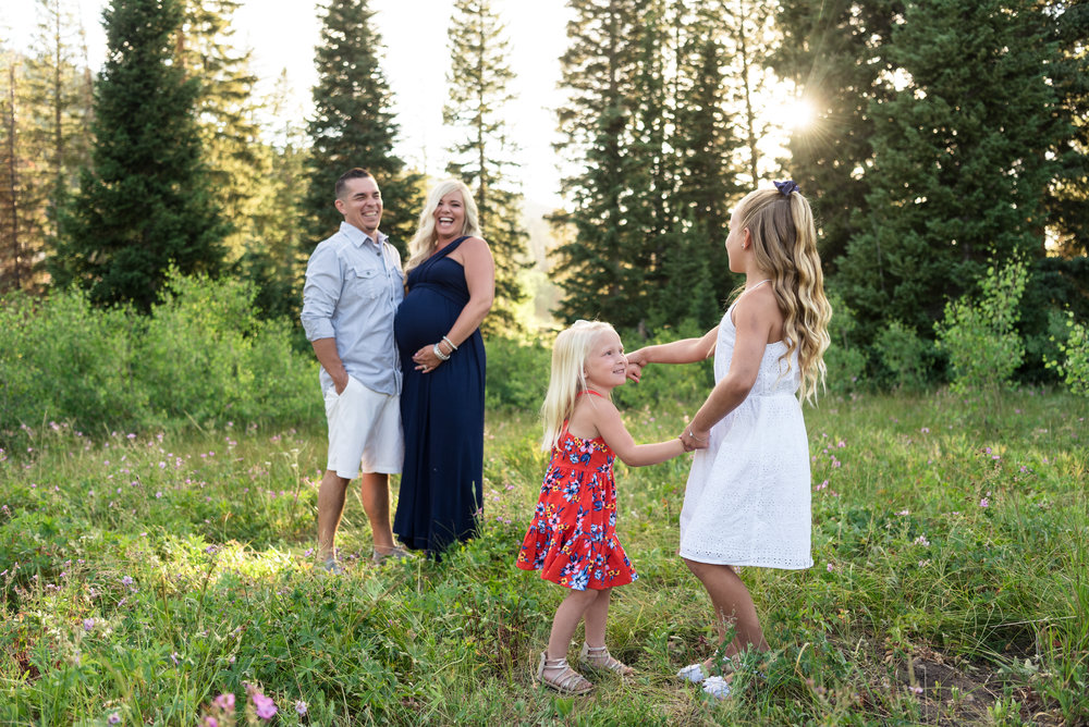 Daughters dancing during Family and Maternity pictures taken in Big Cottonwood Canyon in July.