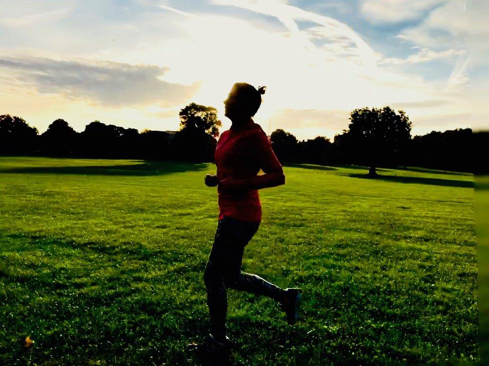 girl running in park outside