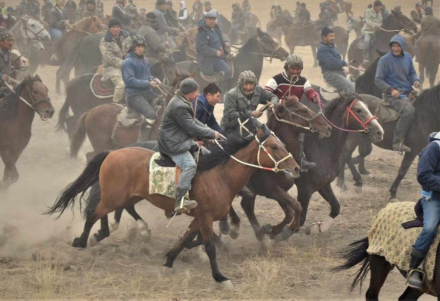 Riders fighting for the goat - notice the whips in the mouths. Hands must be free to grab the goat!