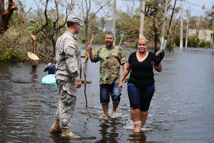 A_Puerto_Rico_National_Guard_Soldier_helps_a_couple_getting_away_from_the_flooded_areas_in_Condado_San_Juan_Puerto_Rico_after_the_path_of_Hurricane_Maria_Photo_by_Sgt_Jose_Ahiram_Diaz_Ramos_PRNG_PAO_CNA.jpg