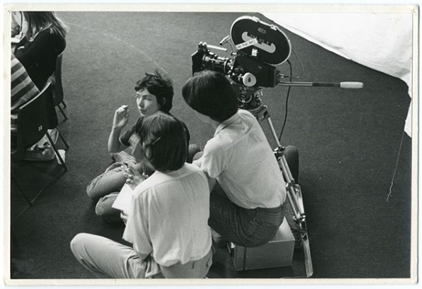 Four Corners members Joanna Davis and Mary Pat Leece filming with a group of women, 1970s © Four Corners Ltd