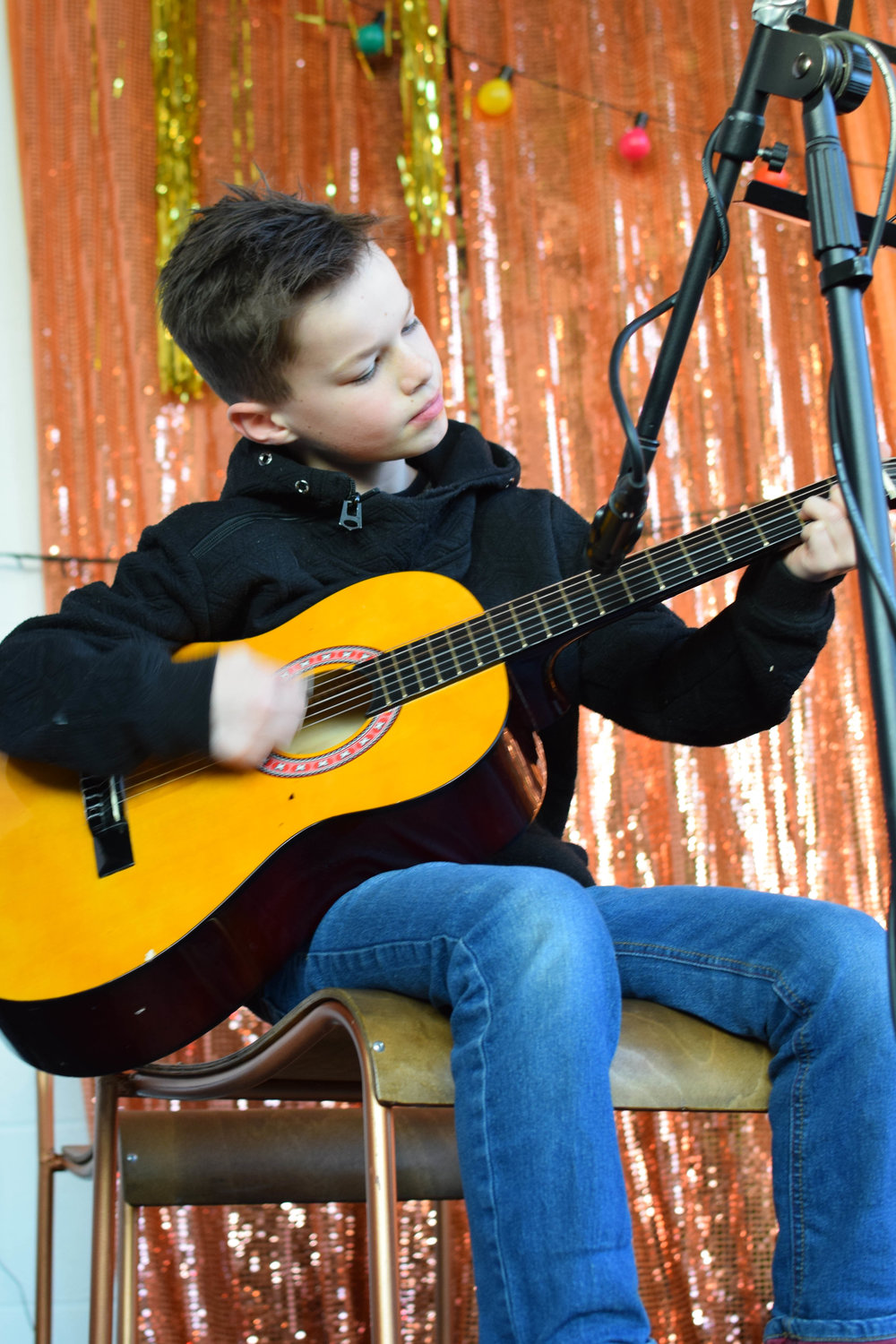 Emile, our student performing guitar on a regular basis.