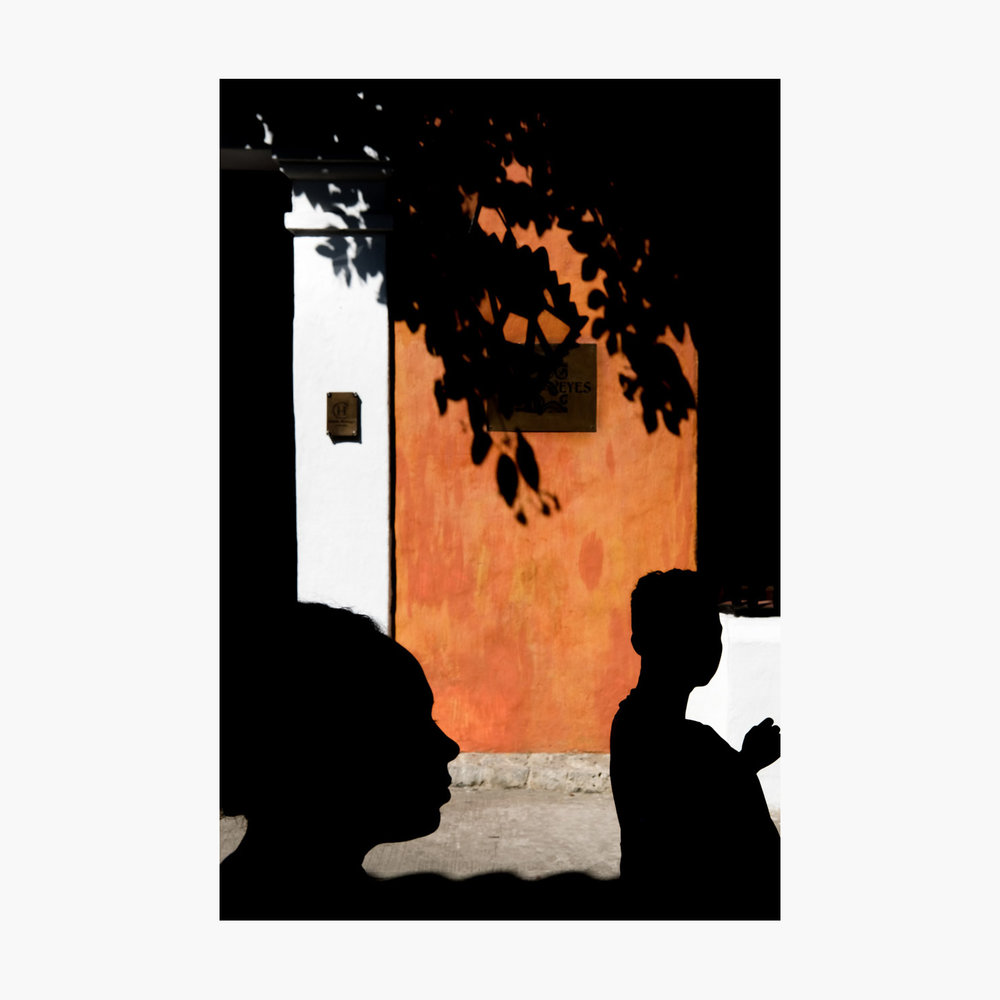 @harrywedmonds  Cartagena, Colombia, South America December 2017  Although I'm primarily a black and white photographer, I couldn't travel across South America without capturing some of that incredible colour.  I love the way the silhouettes become part of the scene here, foreground merging with background. The construction is slightly unconventional—both subjects are at extremes of the frame—but the diagonal shadow leads the eye.  Photographed using the  FujiFilm X-T2  and the  XF35 F2 WR .