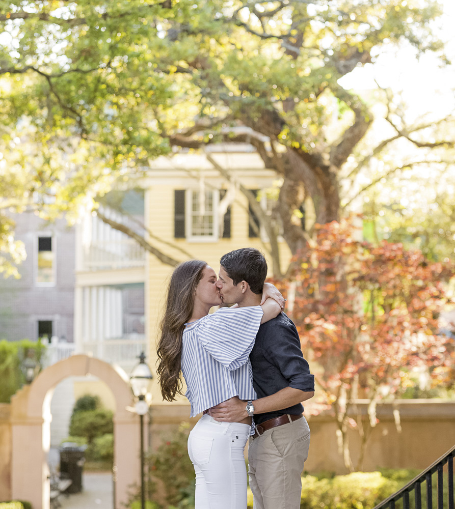 Engaged couple kissing at the College of Charleston