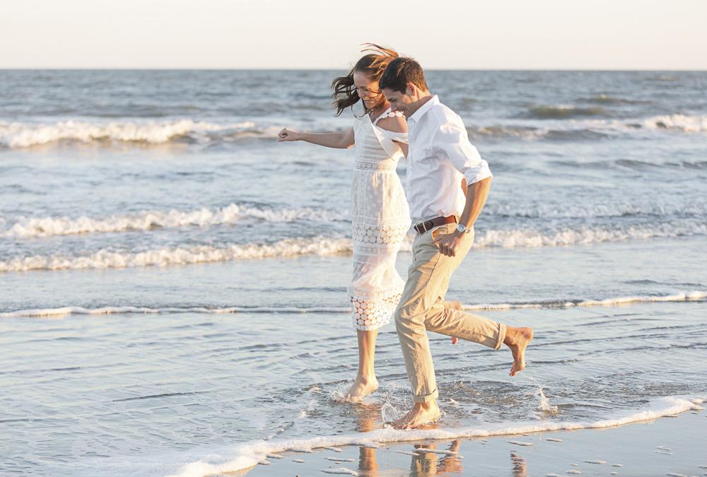 Couple running on Folly Beach