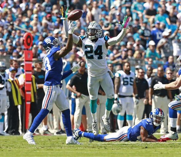 Odell Beckham, Jr. throws a 57 yard touchdown pass to Saquon Barkley during Sunday's game at Carolina.