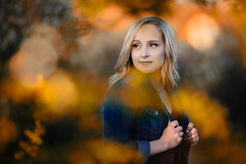 "Probably my favourite image from the session. The light was coming across the open field and falling on the tree perfectly for me to use some smooth ""bokeh"" in the front and of course behind Bryah. She killed this session!"