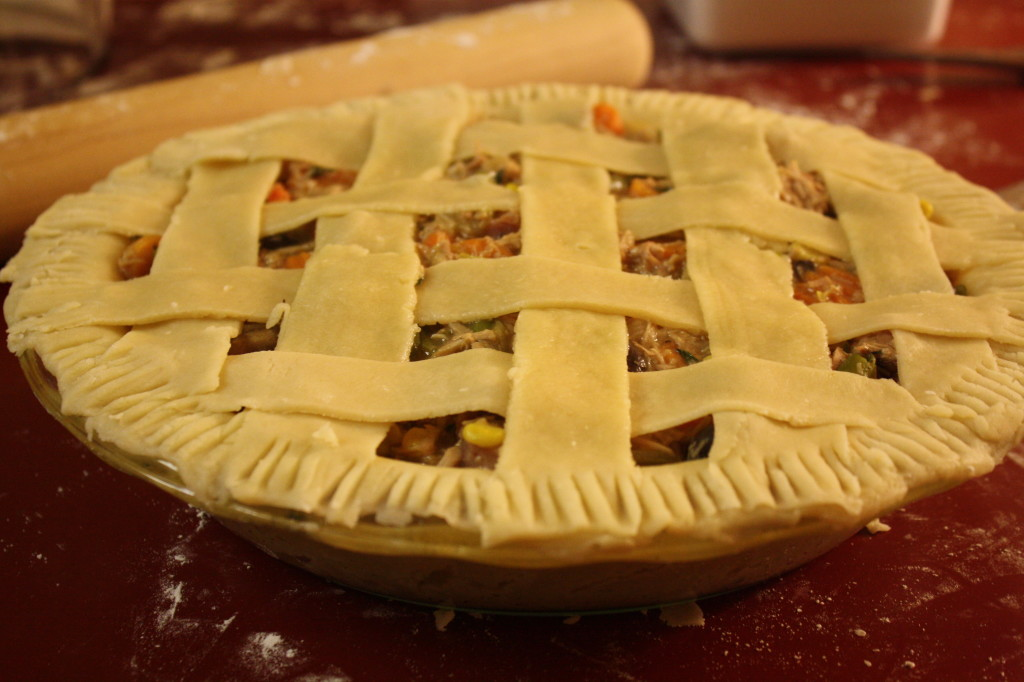 Weave the lattice crust strips, then use a fork to press the strips down into the rest of the pie crust.