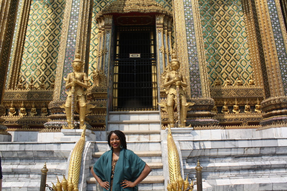 Standing in front of one of the many ornate buildings at the Grand Palace