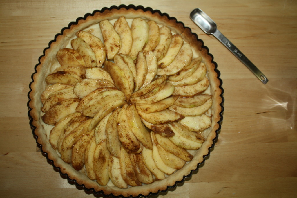 Once the apple wedges are arranged in the crust, bake it in the oven for 20 minutes.