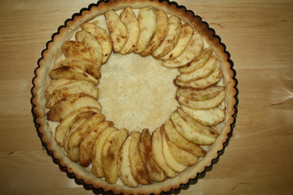 Arrange the apple wedges in a spiral in a par-baked tart crust