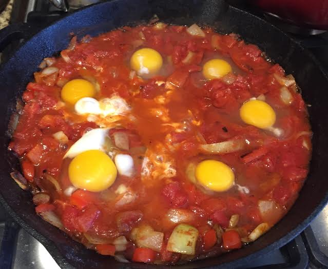 Add eggs, then transfer the cast iron skillet into the oven and bake until eggs are at desired doneness