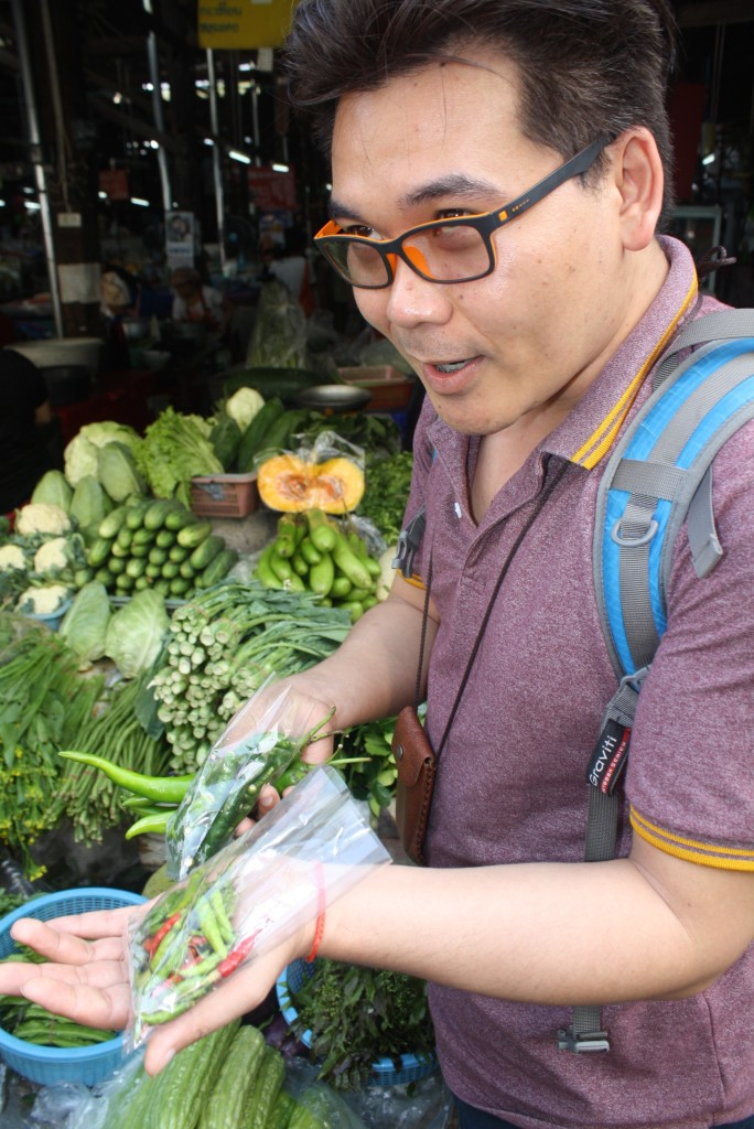 Tom, the owner of the Basil Cookery School, giving us a tour at the market in Chiang Mai